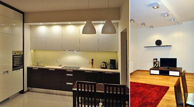 po lewej kuchnia po prawej salon w elitarnym,, luksusowym apartamencie do wynajmu w Krakowie