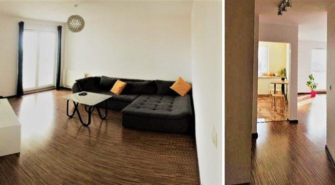 po lewej luksusowy salon, po prawej ekskluzywny przedpokój w prestiżowym apartamencie do wynajmu w Szczecinie
