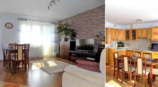 po lewej salon, po prawej kuchnia w ekskluzywnym apartamencie w Ełku na sprzedaż