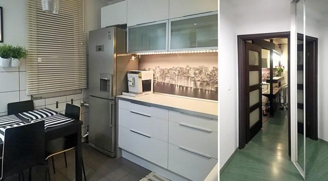po lewej nowoczesny aneks kuchenny, po prawej fragment przedpokoju w luksusowym apartamencie w Kaliszu na sprzedaż