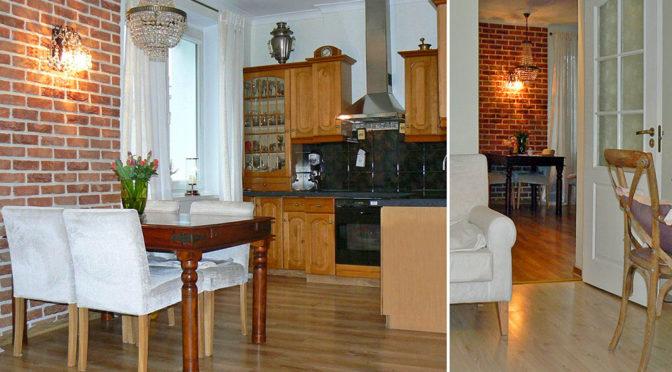 po lewej luksusowy aneks kuchenny, po prawej fragment przedpokoju w ekskluzywnym apartamencie w Zielonej Górze na sprzedaż