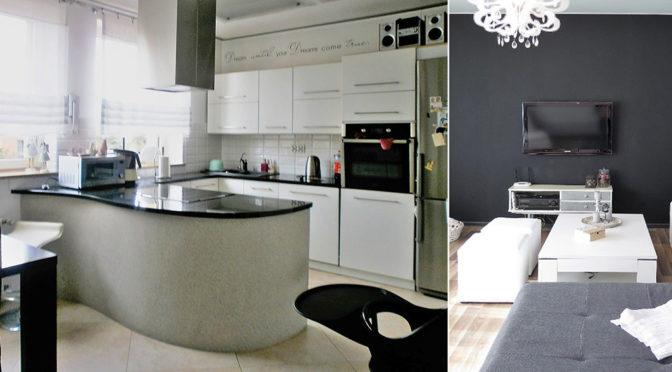 po lewej nowoczesna kuchnia, po prawej fragment salonu w ekskluzywnej rezydencji do sprzedaży w Częstochowie