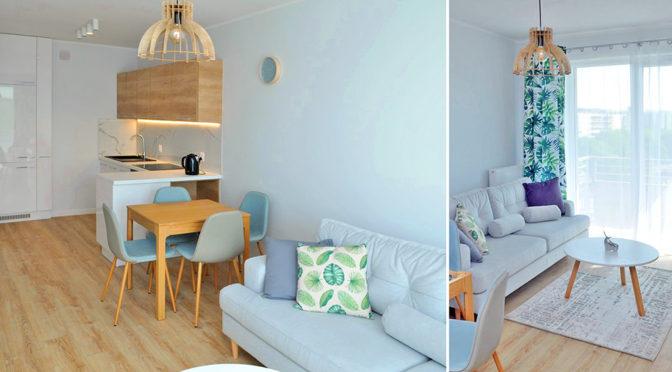 po lewej kuchnia, po rpawej salon w ekskluzywnym apartamencie do wynajmu w Szczecinie