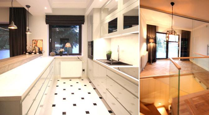 po lewej nowoczesna kuchnia, po prawej fragment salonu w ekskluzywnej rezydencji do wynajęcia Szczecin