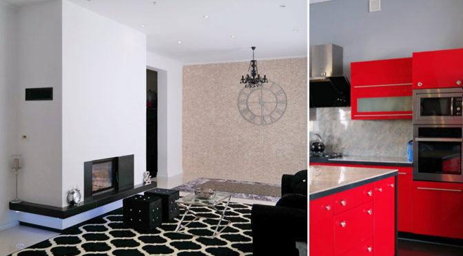 po lewej salon z kominkiem, po prawej nowoczesna kuchnia w luksusowej rezydencji na sprzedaż Zielona Góra