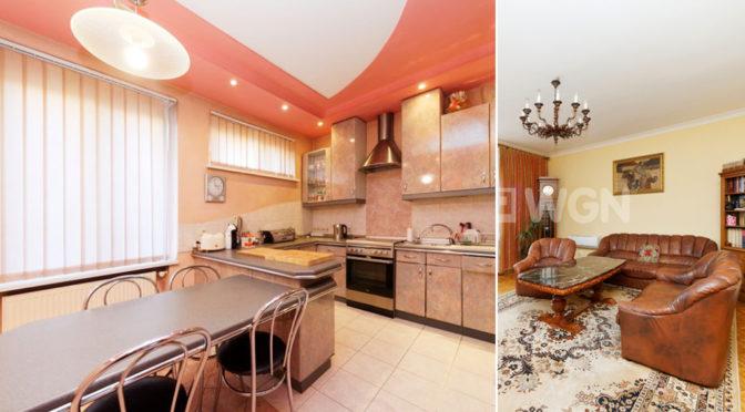 po lewej kuchnia, po prawej fragment salonu w ekskluzywnej rezydencji do wynajmu Tarnów