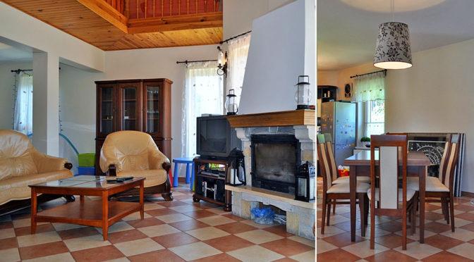 po lewej salon z kominkiem, po prawej fragment jadalni w luksusowej rezydencji na sprzedaż Zielona Góra (okolice)