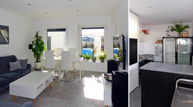 po lewej salon, po prawej kuchnia w luksusowej rezydencji do sprzedaży Ostrów Wielkopolski