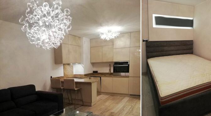 po lewej salon z aneksem kuchenny, po prawej sypialnia w luksusowym apartamencie do wynajmu Katowice