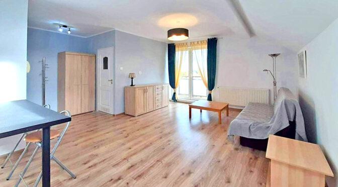 słoneczne wnętrze ekskluzywnego apartamentu do wynajmu Szczecina (okolice)
