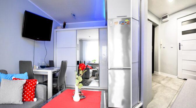 nowoczesne wnętrze, kuchnia i hol, w ekskluzywnym apartamencie na sprzedaż Kalisz