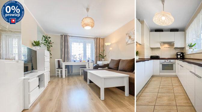imponujące rozmachem wnętrze salonu oraz aneksu kuchennego w luksusowym apartamencie na sprzedaż Katowice (okolice)