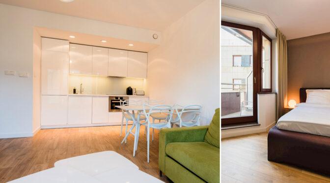 po lewej aneks kuchenny i salon, po prawej sypialnia w ekskluzywnym apartamencie do wynajmu Wrocław