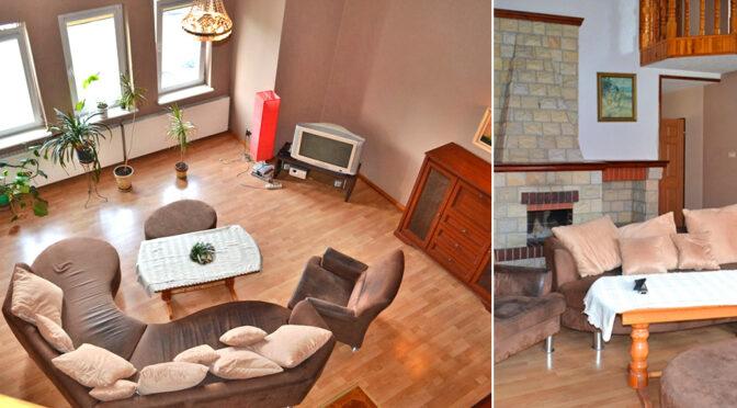 widok z góryn na salon w luksusowym apartamencie na wynajem Bolesławiec