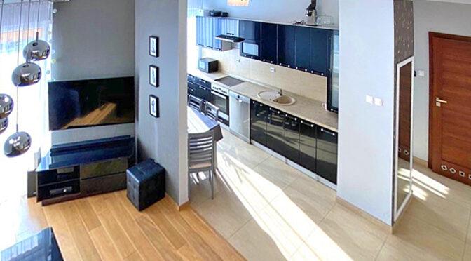 widok z góry na pokój dzienny w luksusowym apartamencie do sprzedaży Szczecin