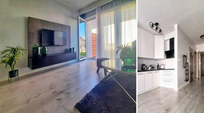 po lewej nowoczesny salon, po prawej kuchnia w luksusowej rezydencji do sprzedaży Leszno