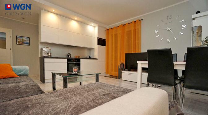komfortowy salon w ekskluzywnym apartamencie na sprzedaż Konin