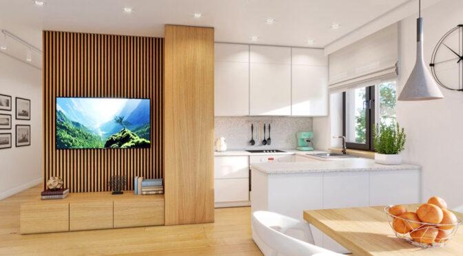 widok z salonu na aneks kuchenny w luksusowym apartamencie na sprzedaż Myszków