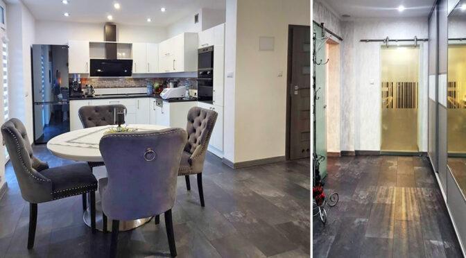 po lewej kuchnia, po prawej hol w luksusowym apartamencie do sprzedaży Żagań