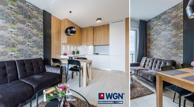 po lewej aneks kuchenny, po prawek salon w ekskluzywnym apartamencie do wynajęcia Gdańsk
