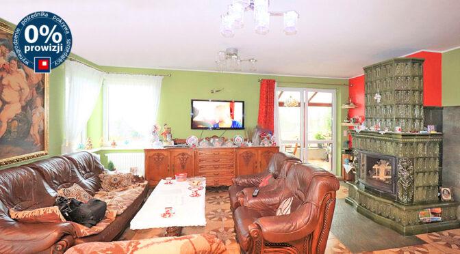 kameralny salon z kominkiem w ekskluzywnej rezydencji do sprzedaży Ustroń