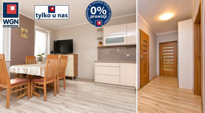 po lewej kuchnia, po prawej hol w ekskluzywnym apartamencie na sprzedaż Gdańsk