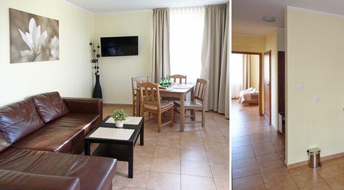 po lewej salon, po prawej hol w luksusowym apartamencie do sprzedaży nad morzem