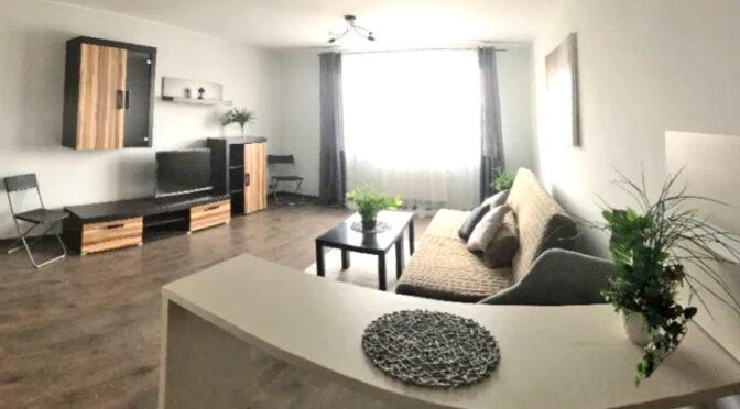 przestronny pokój dzienny w luksusowym apartamencie do wynajęcia Szczecin