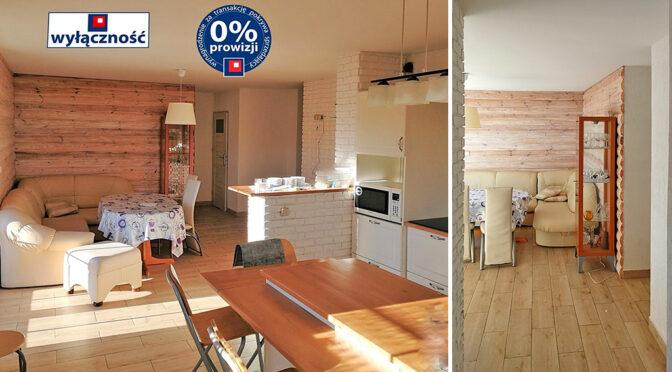 po lewej salon, po prawej hol w luksusowej rezydencji do sprzedaży Wisła