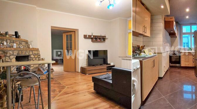 po lewej salon, po prawej kuchnia w ekskluzywnym apartamencie na sprzedaż Częstochowa