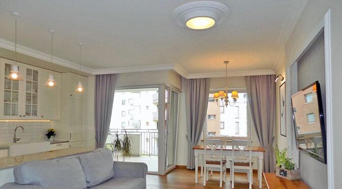 stylowy pokój dzienny w ekskluzywnym apartamencie do sprzedaży Ełk